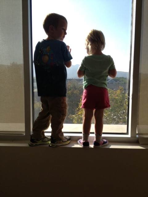 Abigail's kids checking out the view of Griffith Park from the new office windows