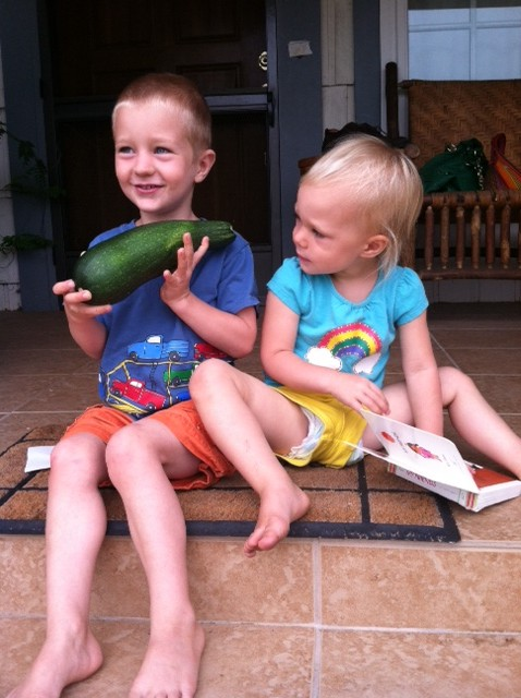 My kids, last summer, with a giant zucchini they picked